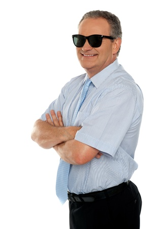 Confident male executive wearing sunglasses and posing with his arms crossed Stock Photo - 14765067