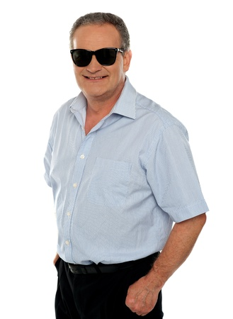 Stylish portrait of casual aged male model posing against white background photo