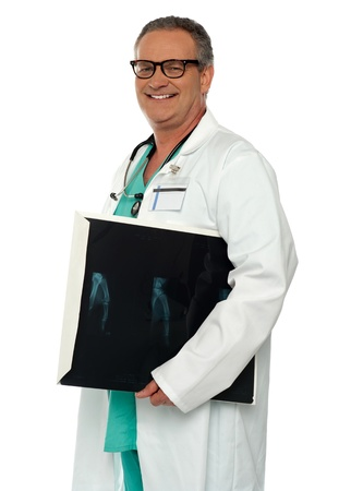 Smiling doctor carrying x-ray report of hand bone. All on white background photo