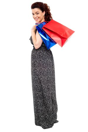Full length portrait of shopaholic woman carrying shopping bags Stock Photo - 15030386