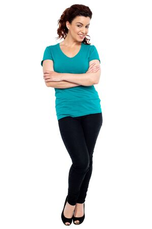 Full length portrait of cheerful woman posing with her hands crossed Stock Photo - 15030174