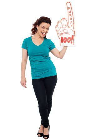 hurray: Woman cheering with large boo hurray foam hand. Full length portrait
