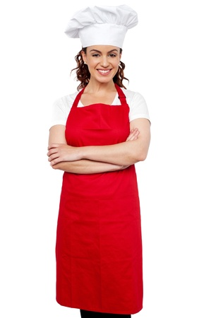 toque: Profile shot of a young charming female chef wearing red apron and toque Stock Photo