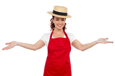 welcoming: Pretty chef welcoming you with her arms stretched isolated over white background Stock Photo