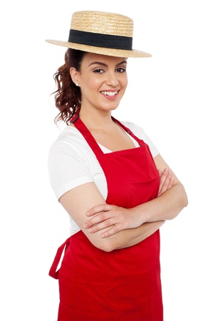 Baker woman posing casually with arms crossed looking at you photo