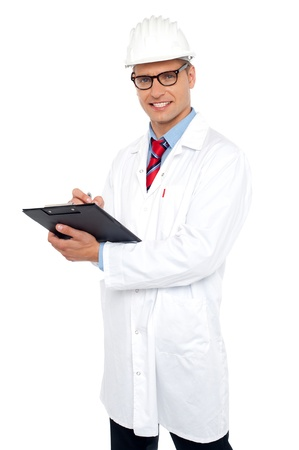 Engineer preparing report looking at you. All on white background Stock Photo - 15030179