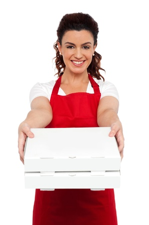 aprons: Here is your order sir. Hot pizza at your doorstep. Enjoy your meal. Woman delivering pizza