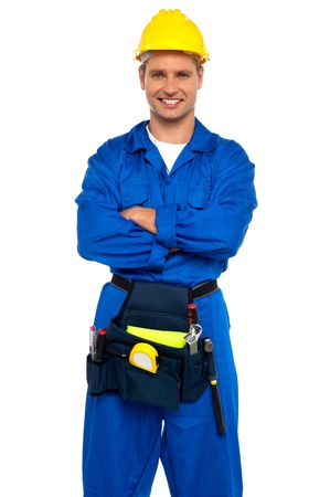 Young industrial contractor posing with crossed arms isolated over white background photo
