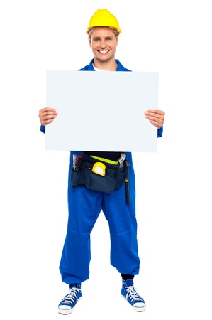 Industrial contractor showing blank billboard, full length shot photo