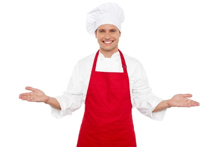 Joyful chef welcoming his guests with wide open arms. All on white background photo