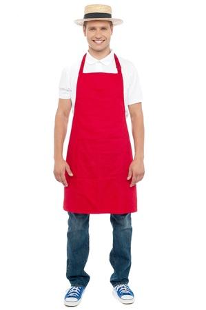 delantal: Chef con un sombrero aislado sobre fondo blanco. Retrato de cuerpo entero Foto de archivo