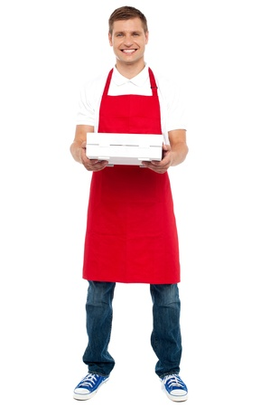 Full length portrait of male chef holding pie box isolated against white background Stock Photo - 15030200