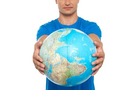 Closeup shot of man holding globe isolated over white photo
