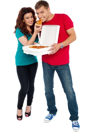 Couple enjoying pizza together, great bonding. Full length shots photo