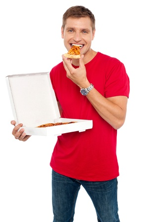 italian man: Cool young guy enjoying pizza isolated over white background