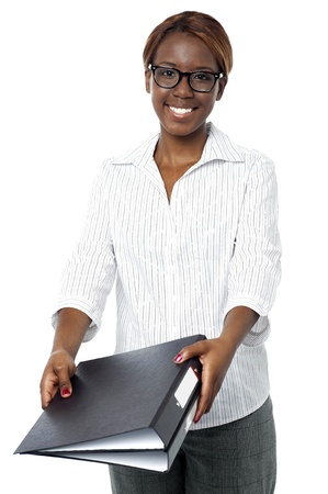 submitting: Confident female secretary submitting her binder to her boss