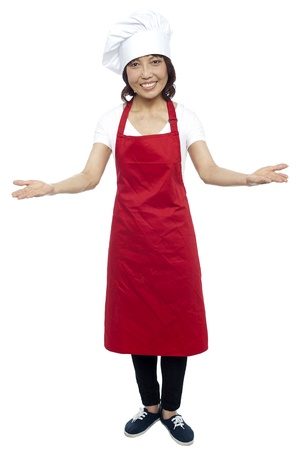 asian cook: I welcome you my guests. Asian female chef posing with arms wide spread, grand welcome.