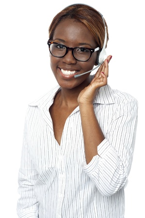 Confident african representative answering clients call wearing headsets photo