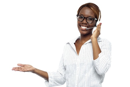 Customer service representative attending calls. Making gestures with hand while explaining it to client photo