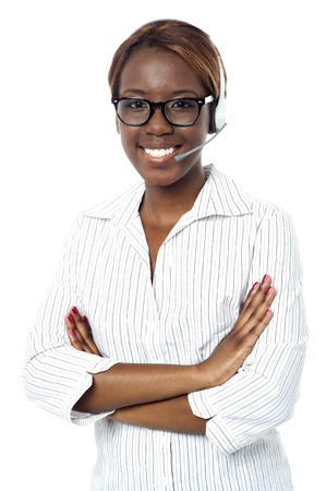 Confident operator lady smiling, wearing headset. All on white background Stock Photo - 15138772