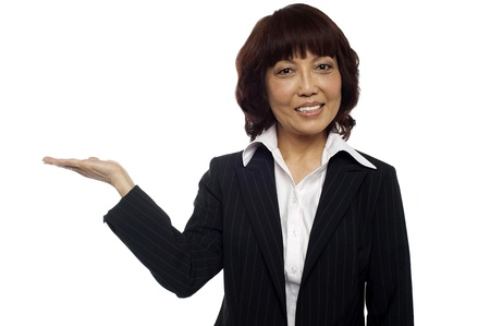 half dressed: Asian business lady presenting copy space. Looking at camera Stock Photo