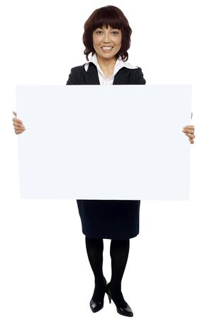 Isolated experienced asian businesswoman holding blank white billboard photo