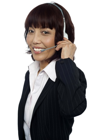 Customer service executive talking to customer through headset isolated over white background photo