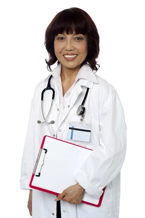 scheduled: Medical expert holding clipboard. Ready to go on her scheduled rounds in hospital. All on white background Stock Photo