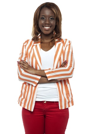 casuals: Trendy young african college girl dressed in casuals standing with her arms crossed