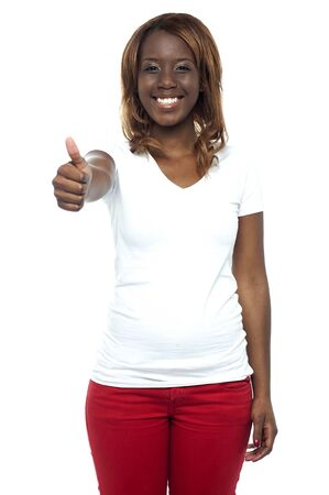 African teenage girl gesturing thumbs up isolated against white background Stock Photo - 15137904