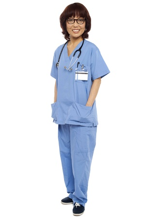Asian surgeon posing with hands in her coat pocket isolated against white Stock Photo - 15137706