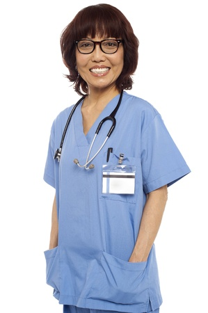Relaxed female surgeon posing casually. Isolated on white photo