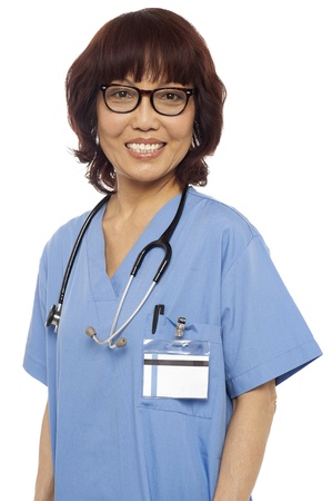 Pleasing matured asian female gynecologist with stethoscope around her neck