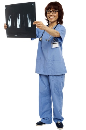 Full length portrait of asian nurse holding x-ray report of patient photo