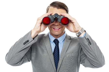 Young officer looking through binoculars, hunting success Stock Photo - 15245421