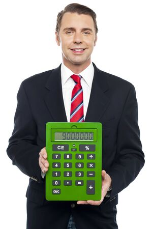 Young businessman showing big green calculator to camera isolated on white photo