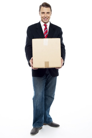 Full length portrait of business representative holding cardboard box photo