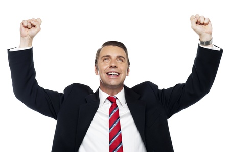 hurray: Successful corporate male, arms raised in excitement Stock Photo
