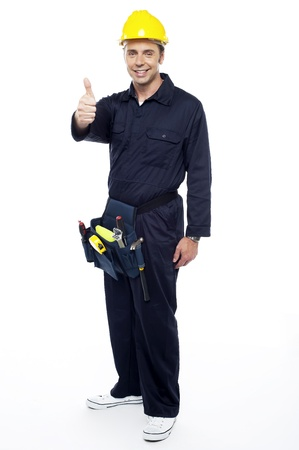 posing  agree: Industrial contractor gesturing thumbs up. Full length portrait Stock Photo