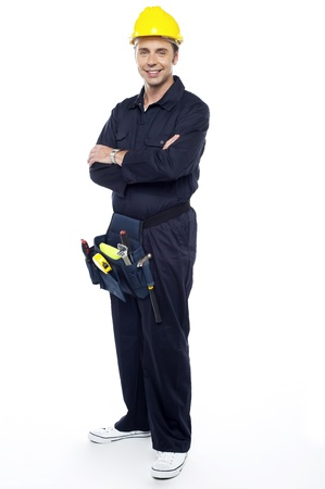 Repairman with tools pouch around his waist posing casually with arms crossed Stock Photo - 15243485