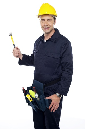 Repairman holding out hammer from his tool kit isolated against white background photo