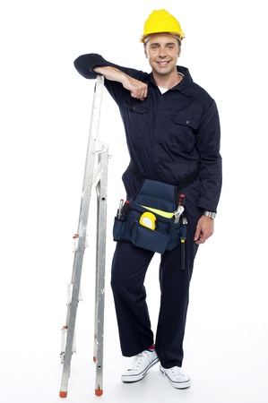 Full length portrait of industrial engineer resting his hands on stepladder Stock Photo - 15243813