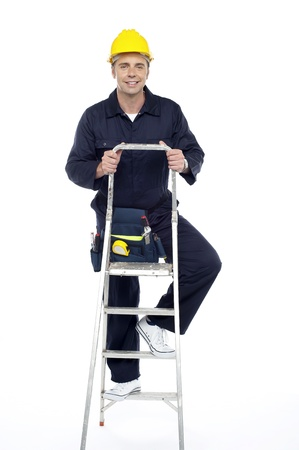 Its work time. Repairman climbing stepladder. All on white background photo