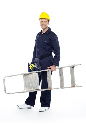 Repairman holding stepladder, ready to go to work. All on white background photo