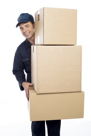 packing boxes: Relocation staff carrying cardboard boxes isolated against white background Stock Photo