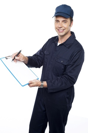 Courier delivery guy getting signature from customer after the delivery Stock Photo - 15243877