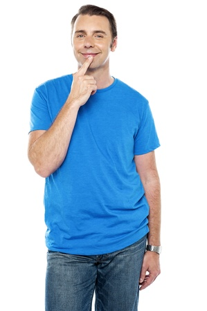 blushing: Young guy blushing, posing in casuals. All on white background Stock Photo