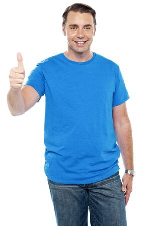Smart young male showing thumbs up to camera Stock Photo - 15245311