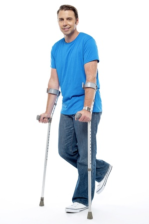 accidental: Young man with crutches trying to walk. Accidental case