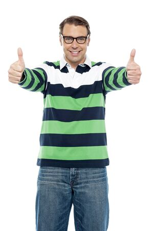 yup: Cool guy showing double thumbs up to camera isolated over white background